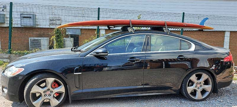 roof racks and paddle board on car